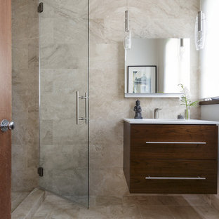 Photo of a small mediterranean shower room in San Francisco with flat-panel cabinets, brown cabinets, an alcove shower, a wall mounted toilet, beige tiles, marble tiles, white walls, marble flooring, a submerged sink, marble worktops, beige floors and a hinged door.