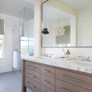 Country bathroom in San Francisco with flat-panel cabinets, light wood cabinets, white walls, an undermount sink, grey floor, white benchtops, a double vanity, a freestanding vanity, timber and planked wall panelling.