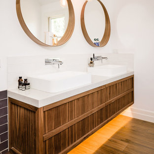Trendy medium tone wood floor bathroom photo in Melbourne with a vessel sink, medium tone wood cabinets and white walls