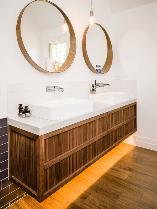 Trendy Medium Tone Wood Floor Bathroom Photo In Melbourne With A Vessel Sink