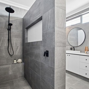 Contemporary 3/4 bathroom in Perth with flat-panel cabinets, white cabinets, an open shower, gray tile, a vessel sink, grey floor and an open shower.