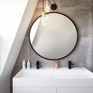 Small contemporary shower room bathroom in London with grey tiles, porcelain tiles, porcelain flooring, solid surface worktops, double sinks, a floating vanity unit, flat-panel cabinets, white cabinets, an integrated sink and white worktops.