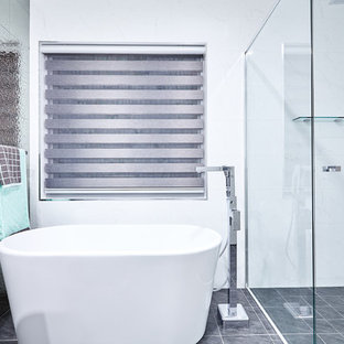 Inspiration for a contemporary master bathroom in Perth with a freestanding tub, a corner shower, white tile and white walls.