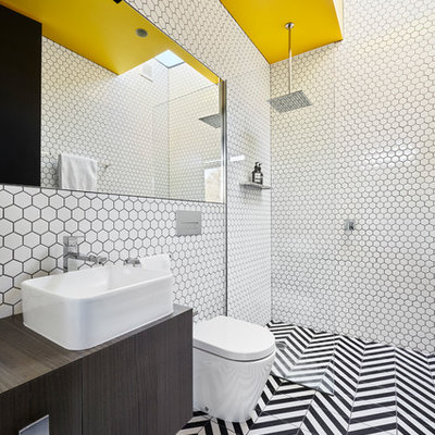 Inspiration for a contemporary 3/4 porcelain tile multicolored floor bathroom remodel in Melbourne with flat-panel cabinets, dark wood cabinets, a wall-mount toilet, white walls, a vessel sink and wood countertops