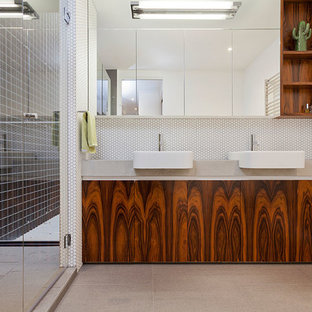 Photo of a contemporary bathroom in Melbourne with flat-panel cabinets, medium wood cabinets, an alcove shower, white walls and a drop-in sink.