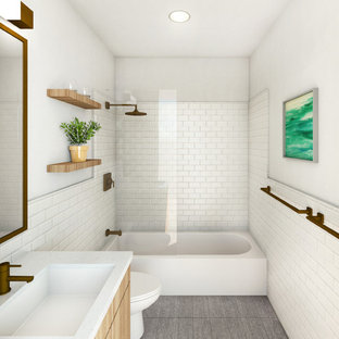 Inspiration for a small modern white tile and subway tile cement tile floor and gray floor bathroom remodel in New York with flat-panel cabinets, medium tone wood cabinets, white walls, an undermount sink, quartz countertops and white countertops