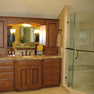 Mid-sized elegant master beige tile and porcelain tile porcelain tile corner shower photo in San Francisco with an undermount sink, recessed-panel cabinets, medium tone wood cabinets, granite countertops, a two-piece toilet and beige walls