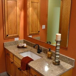 Inspiration pour une salle d'eau bohème de taille moyenne avec des portes de placard en bois brun, une douche d'angle, un carrelage beige, des carreaux de porcelaine, un mur orange, un sol en carrelage de porcelaine, un lavabo encastré et un plan de toilette en quartz modifié.