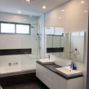 Inspiration for a mid-sized modern kids' white tile and ceramic tile porcelain floor, gray floor, double-sink and coffered ceiling bathroom remodel in Sydney with flat-panel cabinets, white cabinets, a two-piece toilet, white walls, a drop-in sink, quartz countertops, gray countertops, a niche and a floating vanity