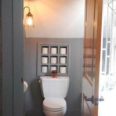 Industrial Bathroom by McMillan Builders LLC