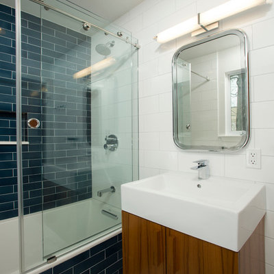 Inspiration for a mid-sized eclectic kids' blue tile and ceramic tile mosaic tile floor bathroom remodel in DC Metro with flat-panel cabinets, medium tone wood cabinets, a one-piece toilet, white walls and a vessel sink