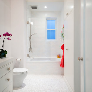Inspiration for a contemporary white tile and subway tile mosaic tile floor and white floor bathroom remodel in San Francisco with flat-panel cabinets and white cabinets