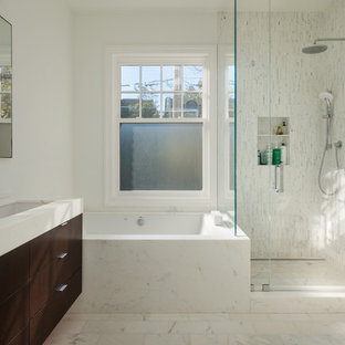 Corner shower - contemporary white tile corner shower idea in San Francisco with a trough sink, flat-panel cabinets, dark wood cabinets and an undermount tub