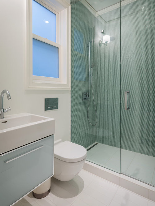 example of a trendy blue tile and mosaic tile alcove shower design in san francisco with