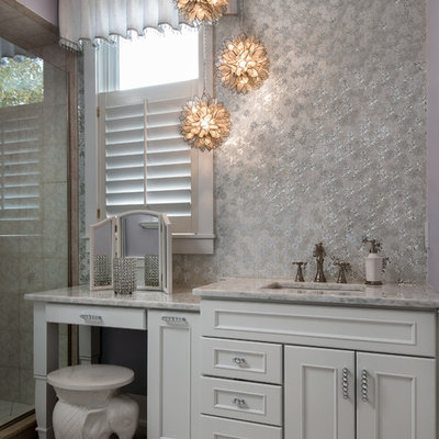 Bathroom - shabby-chic style master bathroom idea in Detroit with raised-panel cabinets, white cabinets and marble countertops