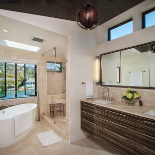 Trendy master beige tile beige floor bathroom photo in San Francisco with flat-panel cabinets, brown cabinets, beige walls, an undermount sink and a hinged shower door