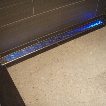 Water-activated LED shower drain