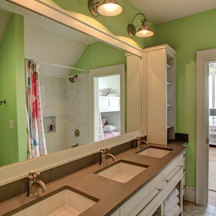 Bathroom - mid-sized traditional kids' beige tile and cement tile ceramic tile bathroom idea in Miami with medium tone wood cabinets, a two-piece toilet, beige walls, an undermount sink and limestone countertops