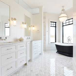 Large transitional master white tile and marble tile marble floor and gray floor bathroom photo in Milwaukee with furniture-like cabinets, white cabinets, white walls, an undermount sink, marble countertops and gray countertops