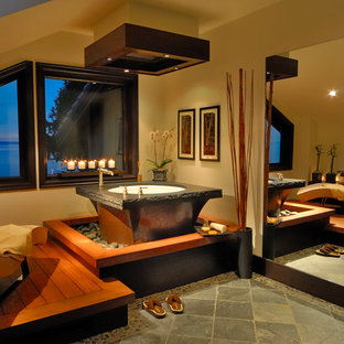 Inspiration for a mid-sized asian master bathroom in Vancouver with a japanese tub, beige walls and ceramic floors.