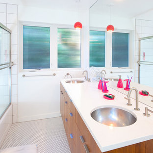 Example of a midcentury modern white tile tub/shower combo design in Seattle with an undermount sink, flat-panel cabinets, medium tone wood cabinets and white walls