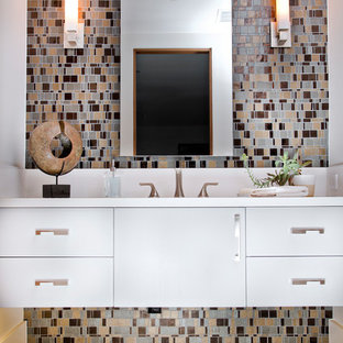 Trendy multicolored tile and mosaic tile brown floor bathroom photo in Orange County with flat-panel cabinets, white cabinets, white walls and white countertops