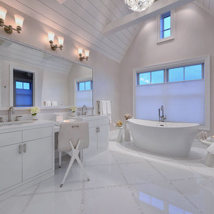 Trendy master freestanding bathtub photo in New York with flat-panel cabinets, white cabinets, gray walls and an undermount sink