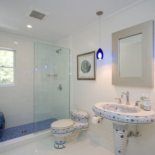 Bathroom - transitional white tile white floor bathroom idea in New York with a pedestal sink