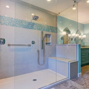 Bathroom - coastal master bathroom idea with raised-panel cabinets