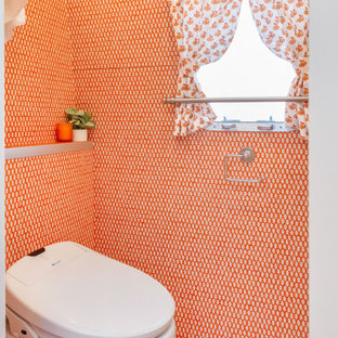 Bathroom - small eclectic 3/4 orange tile painted wood floor and orange floor bathroom idea in Los Angeles with flat-panel cabinets, white cabinets, a one-piece toilet, orange walls, an undermount sink, laminate countertops and orange countertops