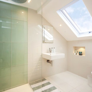 Inspiration for a contemporary bathroom in London with a wall-mount sink, a curbless shower, a one-piece toilet, white tile, white walls and ceramic floors.