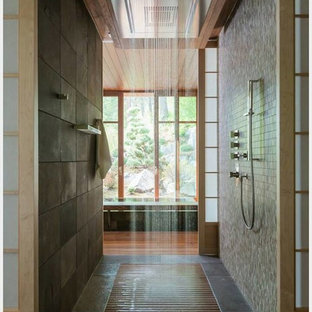 Large asian master bathroom in Seattle with an alcove tub, a curbless shower, brown tile, stone tile, beige walls and ceramic floors.