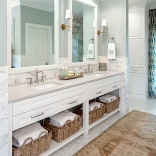 Bathroom - transitional master white tile white floor bathroom idea in Birmingham with recessed-panel cabinets, white cabinets, blue walls and gray countertops