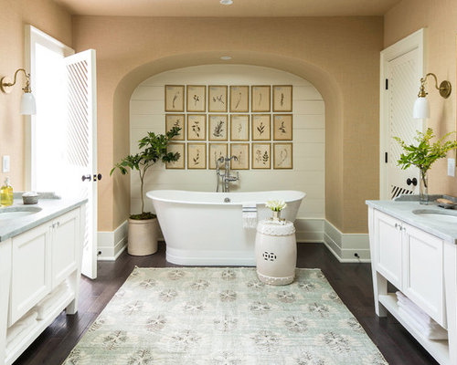 cottage chic master dark wood floor and brown floor bathroom photo in new york with beaded