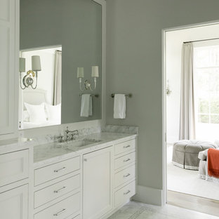 Elegant master bathroom photo in Houston with flat-panel cabinets, white cabinets, gray walls and an undermount sink