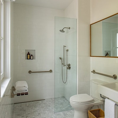 Bathroom - mid-sized contemporary 3/4 white tile and subway tile gray floor bathroom idea in Boston with a two-piece toilet, white walls and a wall-mount sink