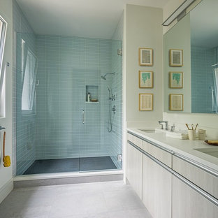 Doorless shower - mid-sized modern master green tile and glass tile porcelain tile and white floor doorless shower idea in Boston with flat-panel cabinets, light wood cabinets, white walls, an undermount sink, quartz countertops and a hinged shower door
