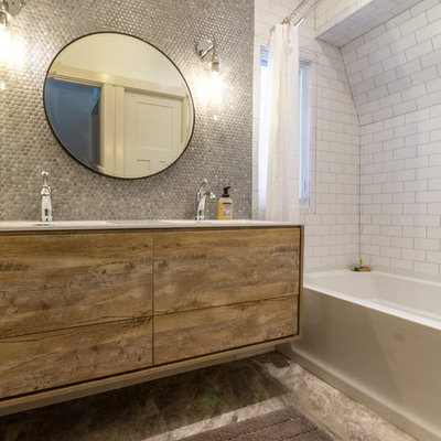 Example of a large eclectic kids' gray tile and ceramic tile ceramic tile and gray floor bathroom design in Other with furniture-like cabinets, light wood cabinets, a two-piece toilet, white walls, an integrated sink, laminate countertops and white countertops