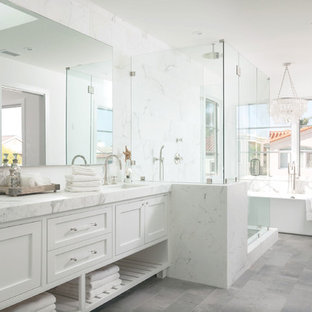 Inspiration for a beach style master white tile bathroom remodel in Orange County with an undermount sink, white cabinets, white walls and shaker cabinets