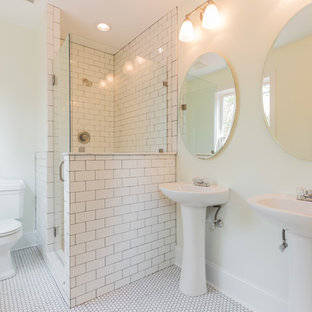 Corner shower - mid-sized traditional 3/4 mosaic tile floor and white floor corner shower idea in Philadelphia with a two-piece toilet, beige walls, a pedestal sink and a hinged shower door