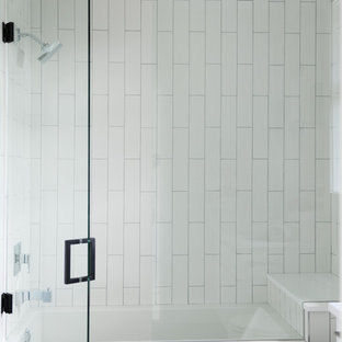 Photo of a contemporary family bathroom in Vancouver with flat-panel cabinets, white cabinets, an alcove bath, a shower/bath combination, white tiles, ceramic tiles, white walls, terracotta flooring, an integrated sink, solid surface worktops, grey floors and a hinged door.