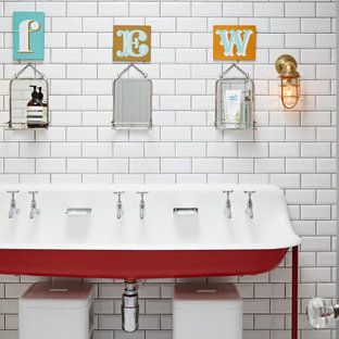 This is an example of a bohemian family bathroom in London with red cabinets, white tiles, metro tiles, a freestanding vanity unit, a trough sink and a single sink.
