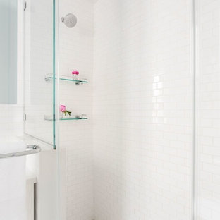 Mid-sized transitional master white tile and subway tile mosaic tile floor and white floor alcove shower photo in New York with shaker cabinets, white cabinets, blue walls, an undermount sink, a hinged shower door and engineered quartz countertops