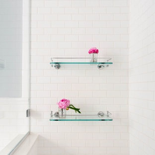 Example of a mid-sized transitional master white tile and subway tile mosaic tile floor and white floor alcove shower design in New York with shaker cabinets, white cabinets, blue walls, an undermount sink, a hinged shower door and engineered quartz countertops