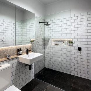 Ispirazione per una stanza da bagno contemporanea con lavabo sospeso, piastrelle bianche, piastrelle diamantate e doccia a filo pavimento