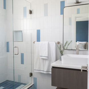 Example of a small beach style 3/4 blue tile, multicolored tile and white tile multicolored floor and single-sink alcove shower design in Los Angeles with marble countertops, flat-panel cabinets, brown cabinets, a floating vanity, multicolored walls, a vessel sink, a hinged shower door, white countertops and a niche