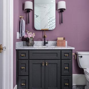 Photo of a contemporary bathroom in Nashville with shaker cabinets, black cabinets, purple walls, mosaic tile floors, an undermount sink, grey floor and white benchtops.