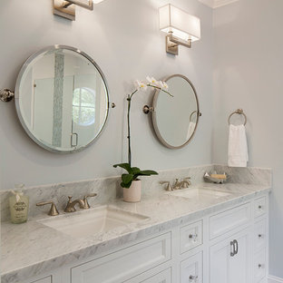 Example of a mid-sized transitional bathroom design in San Francisco with an undermount sink, recessed-panel cabinets, white cabinets and gray walls