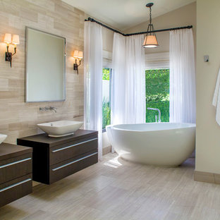 Example of an island style bathroom design in Tampa