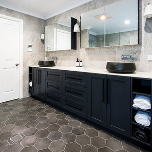 Design ideas for a large transitional master bathroom in Sydney with shaker cabinets, black cabinets, a corner shower, ceramic tile, ceramic floors, a vessel sink, tile benchtops, a hinged shower door, gray tile, grey floor and white benchtops.